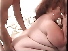 Redhead BBW whore takes to..